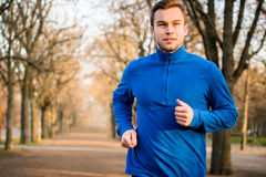 Man jogging in early spring nature Stock Images