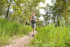 Man jogging in forest Royalty Free Stock Photos