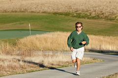 Man Jogging at Golf Course Royalty Free Stock Photos