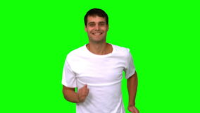 Man jogging on green screen. In slow motion stock video
