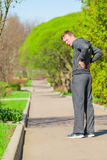 Man while jogging have begun back pain Royalty Free Stock Images