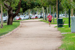 Man jogging on the iconic 'Tan' In Melbourne Stock Photos