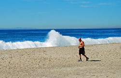 Man jogging on the Main Beach, Laguna Beach, California. Stock Image