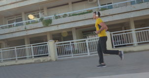 Man jogging with music in the morning stock video