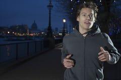 Man Jogging At Night Stock Image