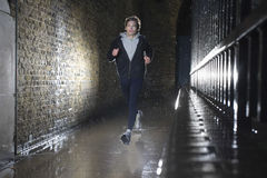 Man Jogging At Night Royalty Free Stock Images