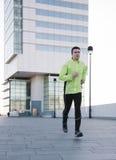 Man jogging outdoor city. Man running outdoor in the road Stock Image