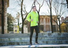 Man jogging outdoor. Man running outdoor in the road Stock Image