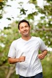 Man jogging outdoors Royalty Free Stock Image