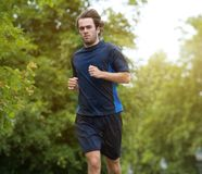 Man jogging outdoors in the forest Stock Photo