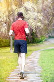 Man jogging outdoors in a park Royalty Free Stock Images