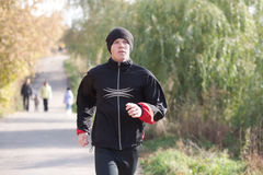 Man jogging in park Royalty Free Stock Images