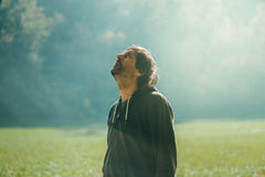 Man jogging in the park in early autumn morning Stock Photography