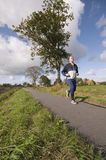 Man jogging on path Royalty Free Stock Images