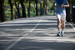 Man jogging in the public park Royalty Free Stock Images