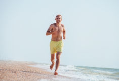 Man jogging on the sea surf line at morning time Royalty Free Stock Photo