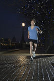 Man Jogging On Street At Night Royalty Free Stock Photos