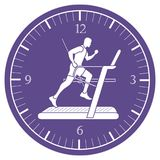 Man jogging on a treadmill and clock. Healthy lifestyle and physical activity Royalty Free Stock Image