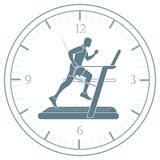 Man jogging on a treadmill and clock. Healthy lifestyle and physical activity Stock Photo
