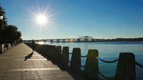 Man jogging on waterfront. Man jogging on the waterfront of Beaufort, South Carolina with sun in background stock video