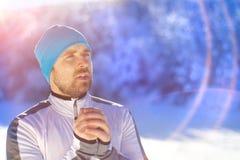 Man jogging in winter nature Stock Image