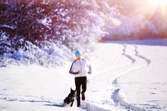Man jogging in winter nature Stock Image