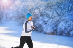 Man jogging in winter nature Royalty Free Stock Photography