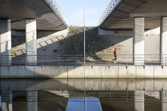 Man jogs under fly-over near De Meern in The Netherlands Royalty Free Stock Photos