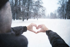 Man join two hands to form a heart shape Royalty Free Stock Photos