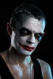 Man joker. Spooky man joker on black background Royalty Free Stock Images
