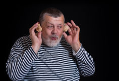 Man joy as a kid listening sounds of sea shell Royalty Free Stock Images