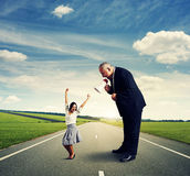 Man and joyful businesswoman. Screaming businessman and joyful businesswoman on the road Stock Photos