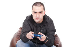 Man with a joystick for game console. Young man with a joystick for game console Royalty Free Stock Image