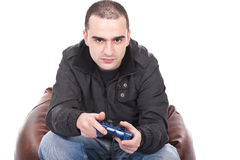 Man with a joystick for game console Stock Photos
