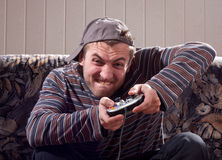 Man with joystick playing video games Stock Image