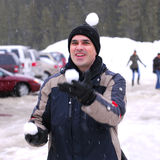 Man juggle snowballs Royalty Free Stock Photos