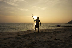 Man juggling on the beach Royalty Free Stock Photos
