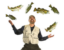 Man Juggling Fish isolated over white background. Hispanic fisherman juggling large and small mouth bass fish isolated over white background royalty free stock images