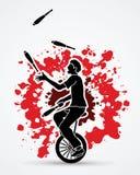A man juggling pins while cycling Royalty Free Stock Image