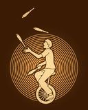 A man juggling pins while cycling Royalty Free Stock Images
