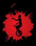 A man juggling pins while cycling Stock Photography