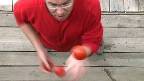 Man juggling with tomatoes