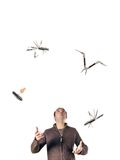 Man juggling tools. Man juggling multi-tools on white background Royalty Free Stock Photos