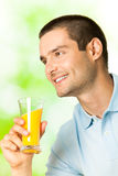Man with juice, outdoors Royalty Free Stock Photos