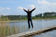 Man juming on pier Royalty Free Stock Images