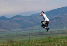 Man jump in air Stock Photography
