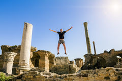 The man in the jump amid the ruins of Carthage in Tunisia Stock Photo