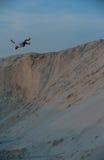 Man in a jump on the beach Royalty Free Stock Photos