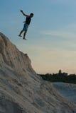 Man in a jump on the beach Stock Photo