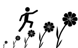 Man jump on flowers Royalty Free Stock Photography